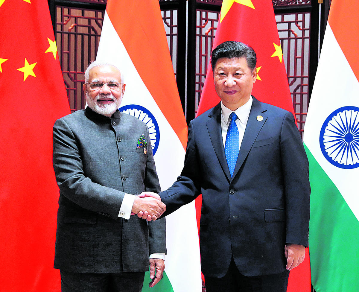 Xiamen : In this photo released by China's Xinhua News Agency, Indian Prime Minister Narendra Modi, left, and China's President Xi Jinping shake hands as they pose for a photo during a meeting on the sidelines of the BRICS Summit in Xiamen in southeastern
