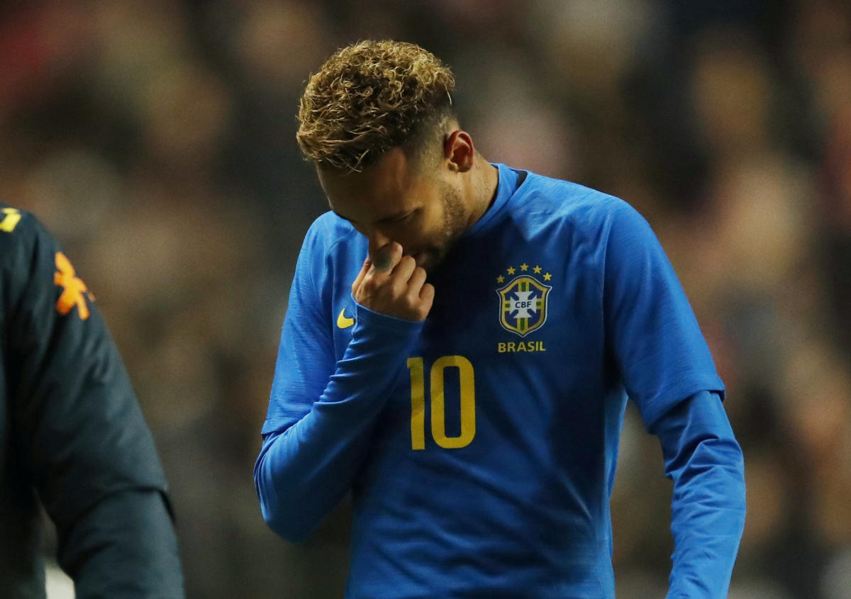 Brazil's Neymar leaves the pitch after suffering an injury. Reuters