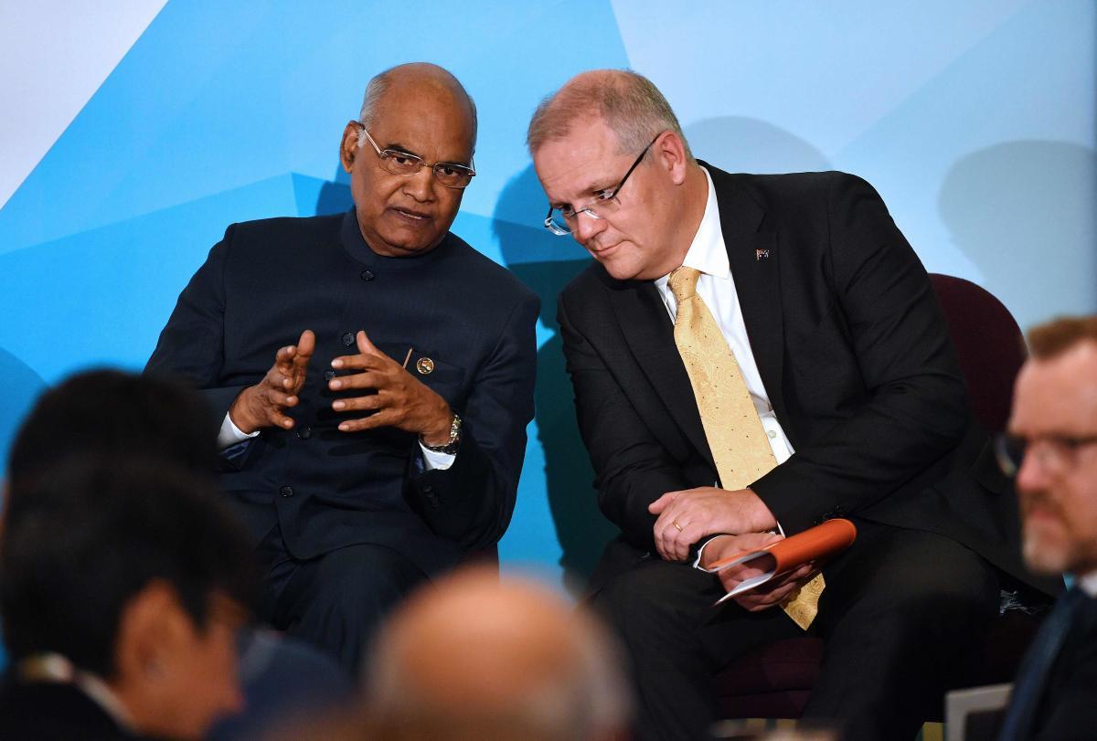 India's President Ram Nath Kovind (L) talks to Australia's Prime Minister Scott Morrison at the Australian Financial Review (AFR) India Business Summit in Sydney onThursday. AFP