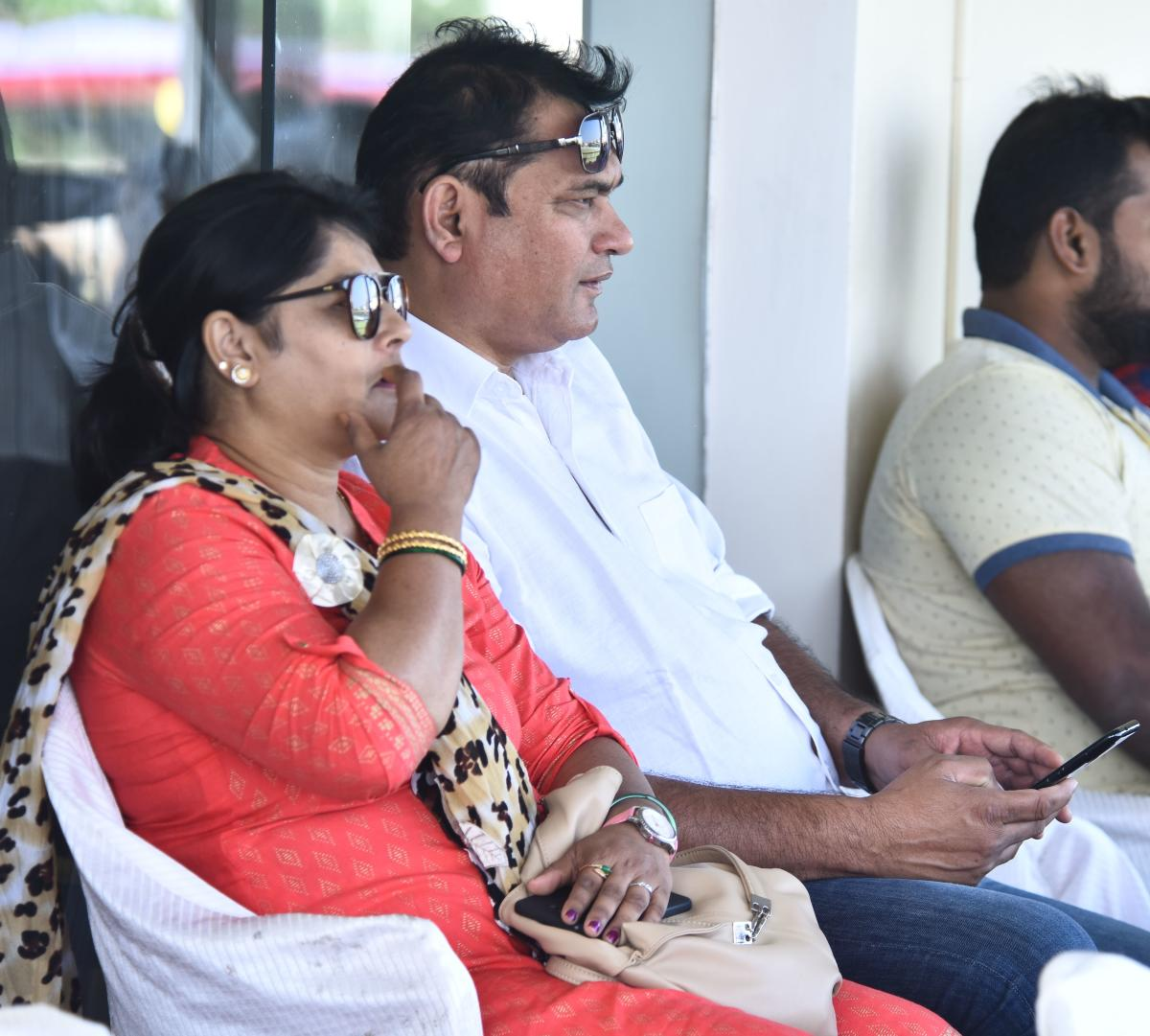 HAPPYDUO: Parents Gajanan More and Sarita More watched their son Ronit bag a crucial five-wicket haul for Karnataka against Mumbai in a Group A Ranji Trophy match in Belagavi on Thursday. DH PHOTO/Tajuddin Azadಪಂದ್ಯ ವೀಕ್ಷಿಸ