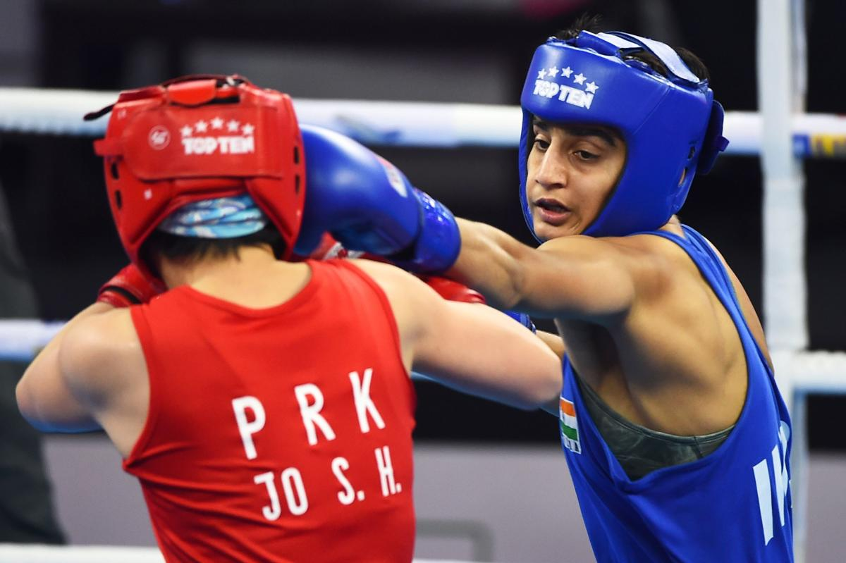 FIGHTER India's Sonia (right) lands a punch on Son Hwa Jo of North Korea in the 57 kg category semifinal of the Women's World Boxing Championships in New Delhi on Friday. AFP