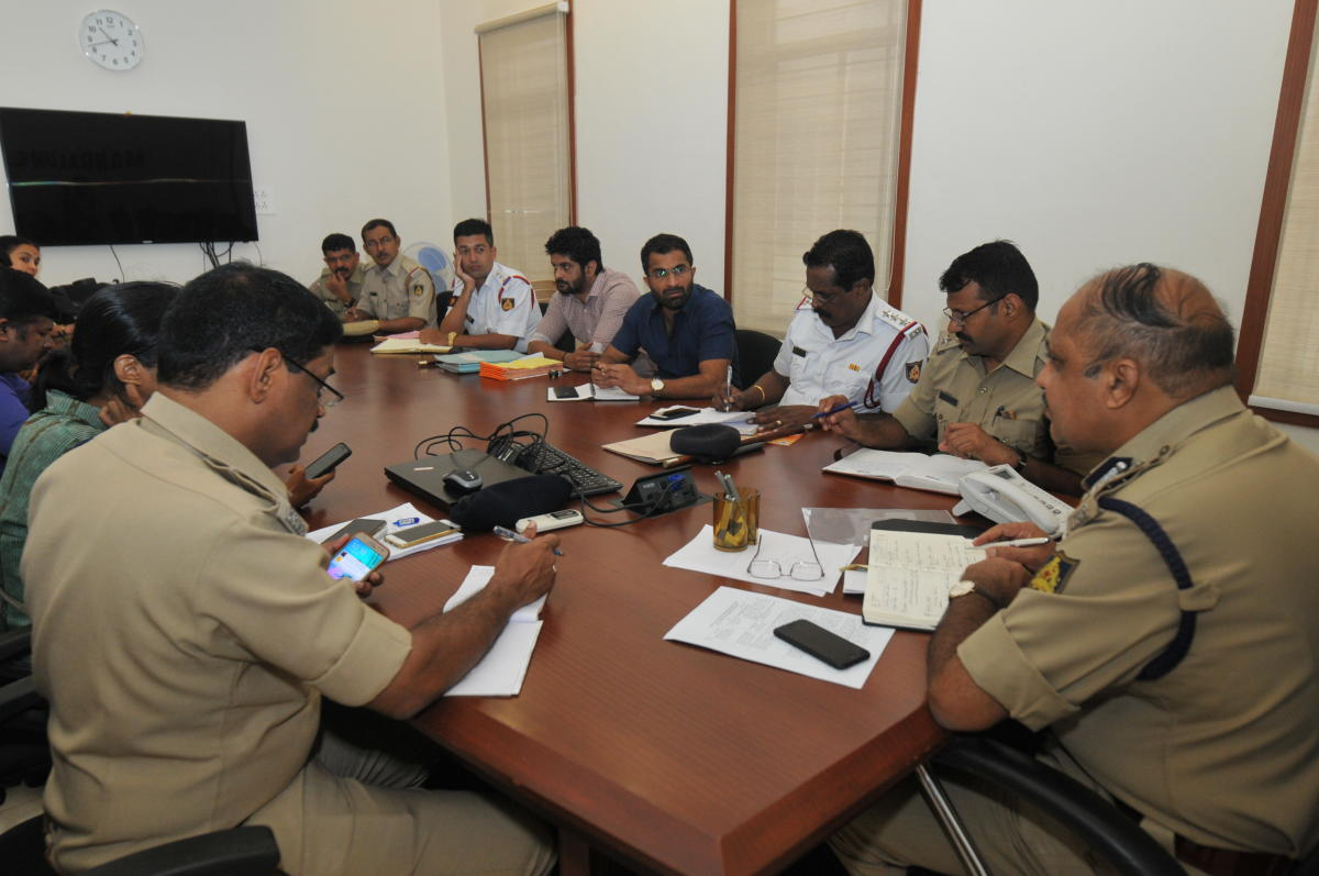 Mangaluru City Police Commissioner T R Suresh attends phone calls during the phone-in programme on Friday.
