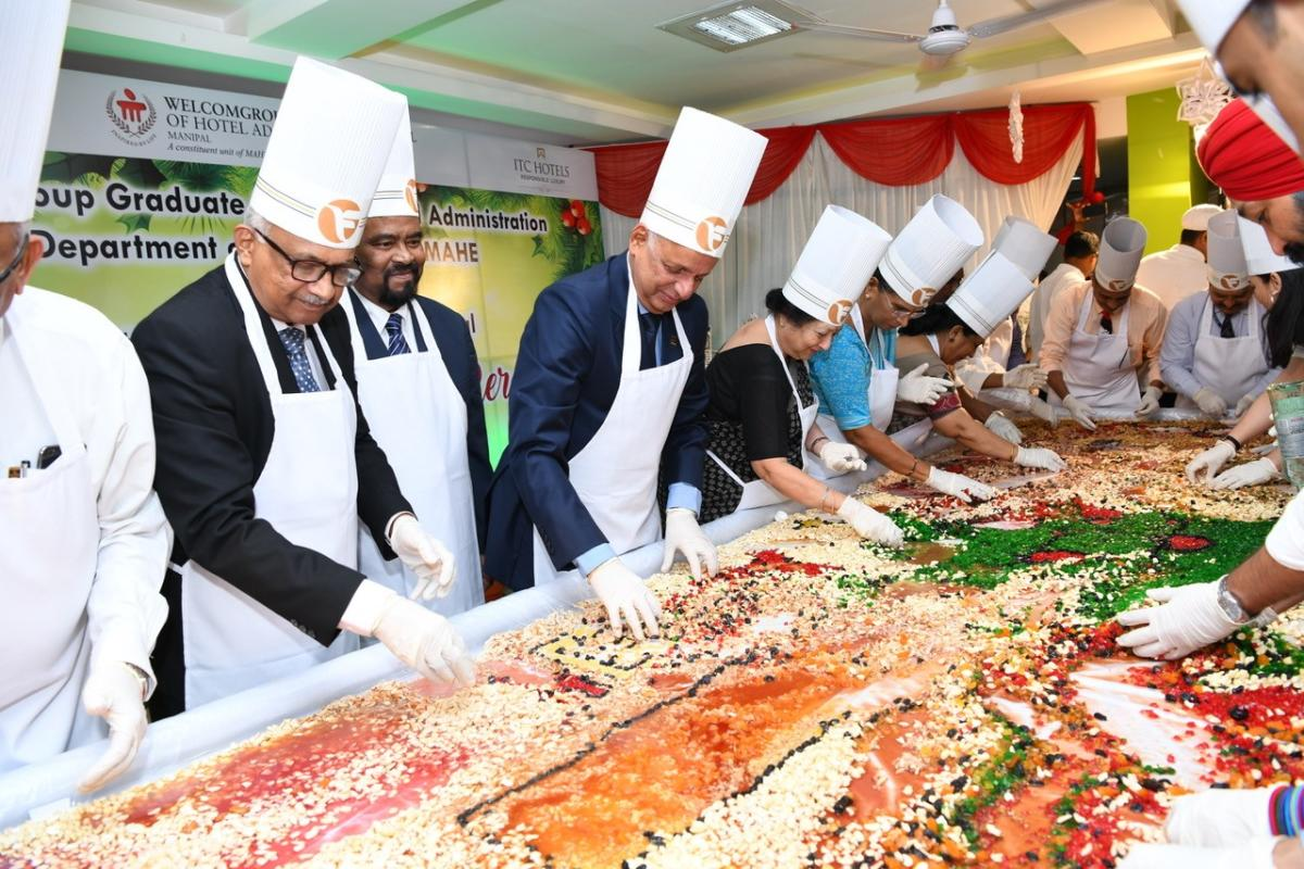 Vasanti R Pai, Trustee MAHE and wife of Chancellor Dr Ramdas M Pai, Dr H S Ballal, Pro Chancellor, Dr H Vinod Bhat, Vice Chancellor and other officials at fruit mixing ceremony for Christmas cake, held at Culinary Arts Hostel Mess, WGSHA.