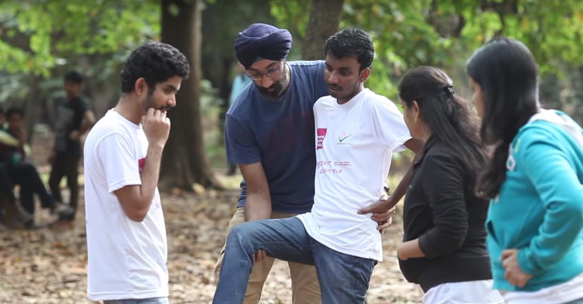 HELPING HAND: A dance instructor trains children with disabilities to dance at Cubbon Park.