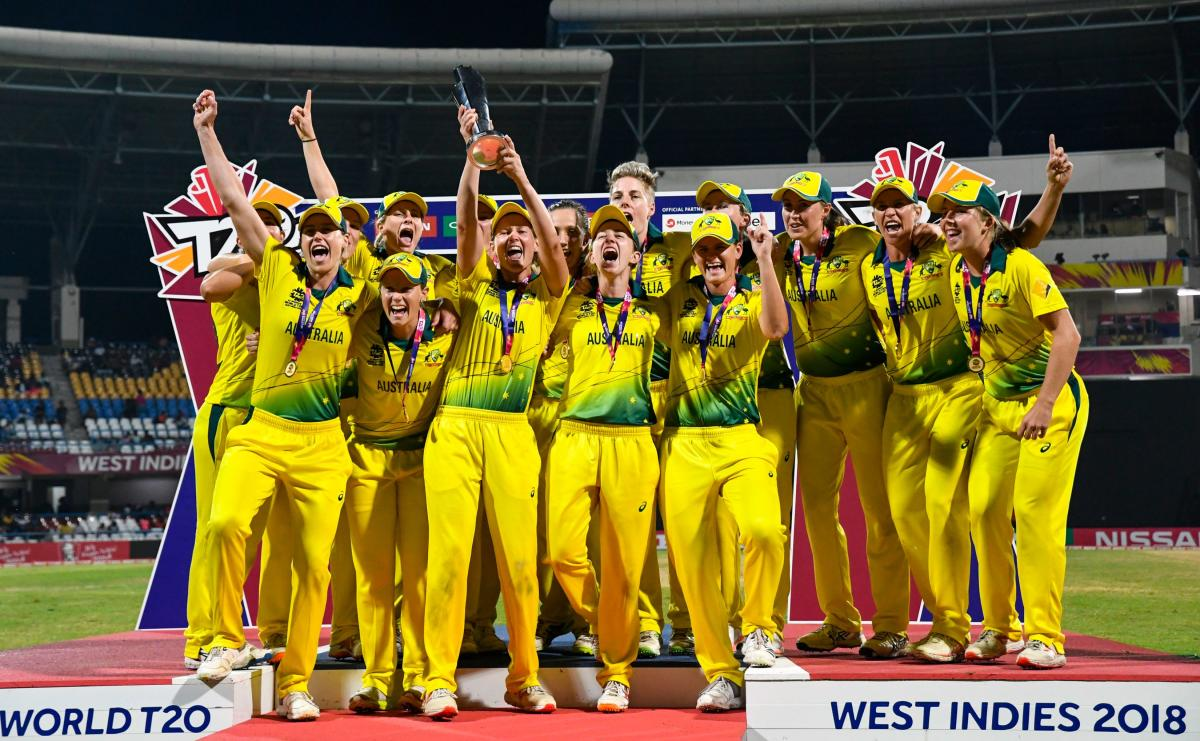 Australia's players celebrate winning the ICC Women's World T20 final cricket match against England at Sir Vivian Richards Cricket Ground, North Sound, Antigua and Barbuda, on November 24, 2018. (Photo by Randy Brooks / AFP)