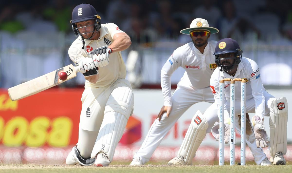 FETCH THAT! England's Jos Buttler sweeps one during his knock of 64 against Sri Lanka on Sunday. AFP