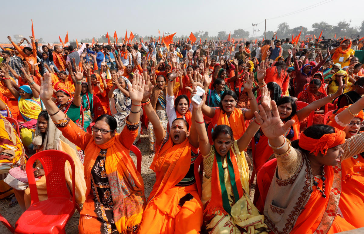 VHP supporters shout slogans during 'Dharma Sabha' in Ayodhya on Sunday. REUTERS