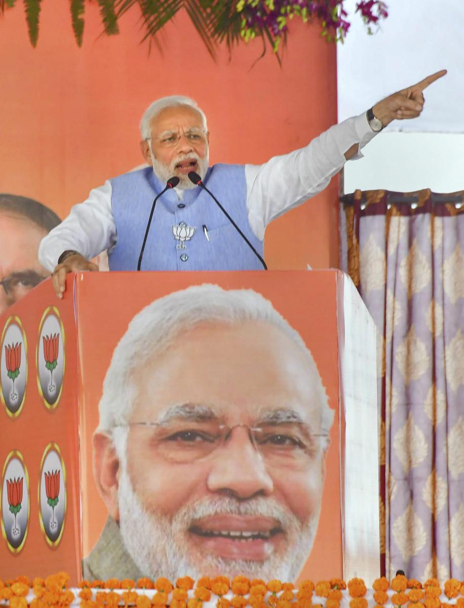 Prime Minister Narendra Modi addresses a public meeting for Madhya Pradesh Assembly elections campaign, in Vidisha on Sunday. PTI