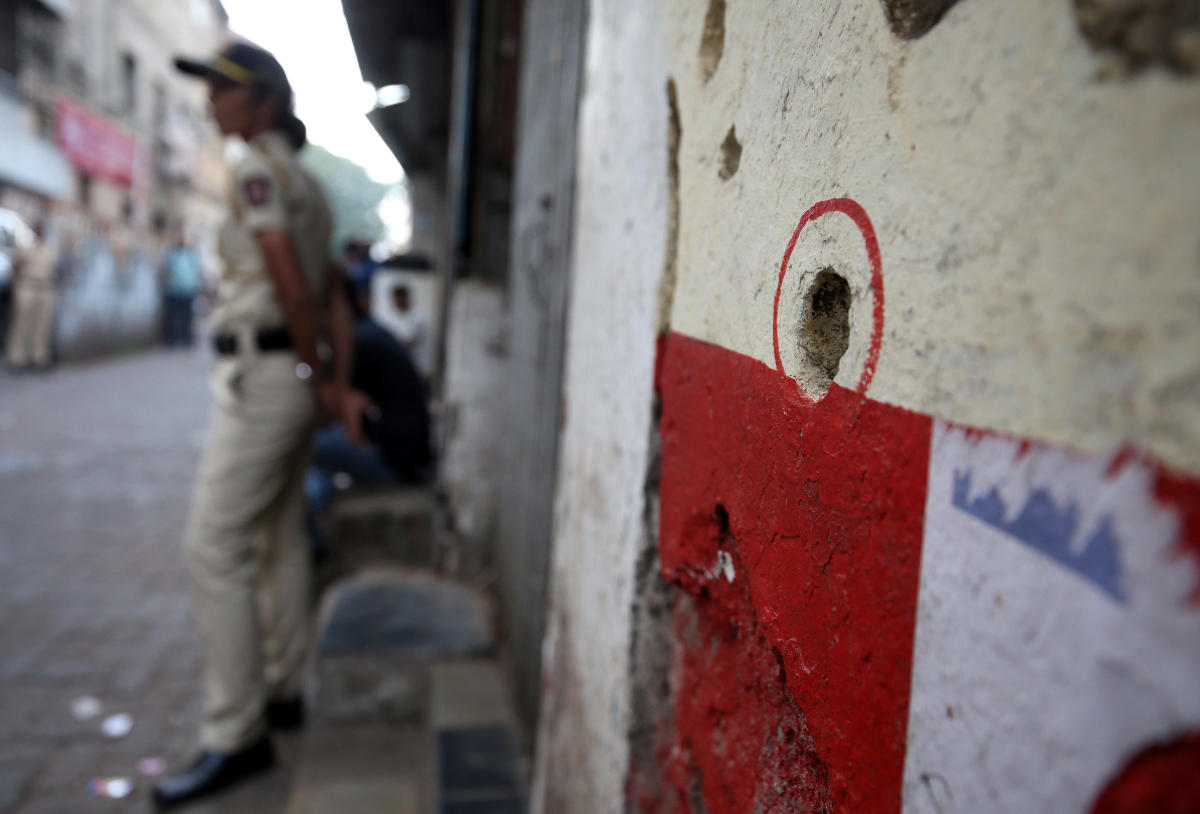 A bullet hole in a wall opposite to the Nariman House, one of the targets of the November 26, 2008 attacks, is pictured after the renaming of Nariman House as Nariman Light House in Mumbai, India, November 25, 2018. REUTERS/Francis Mascarenhas
