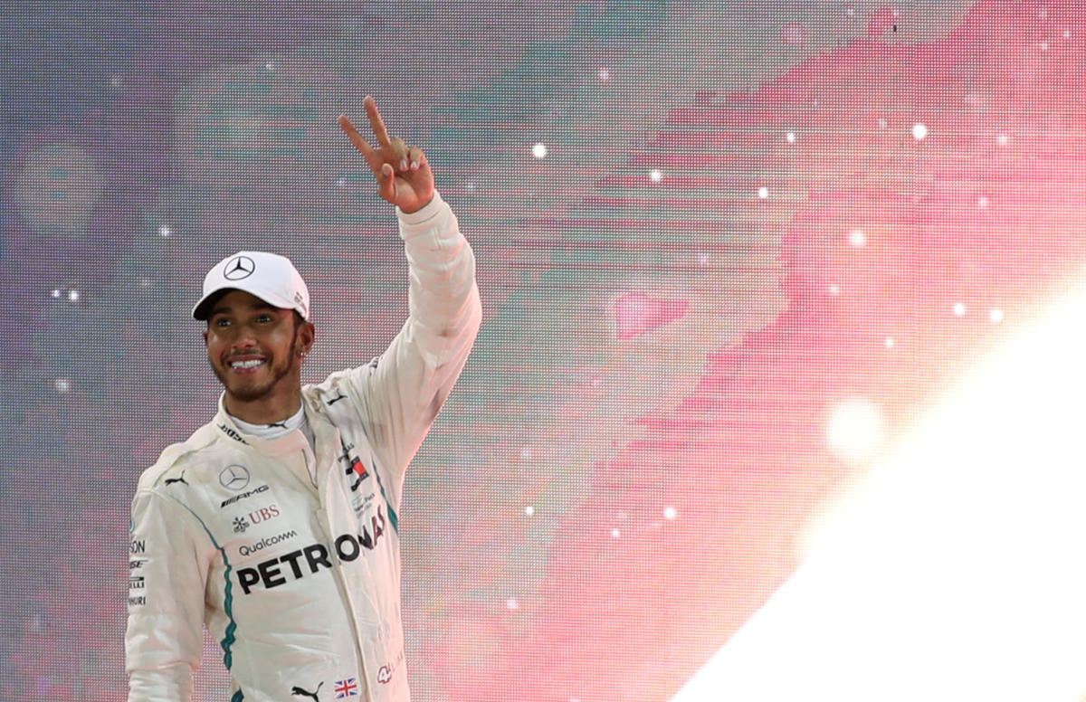 Mercedes' Lewis Hamilton celebrates winning the race. (REUTERS)