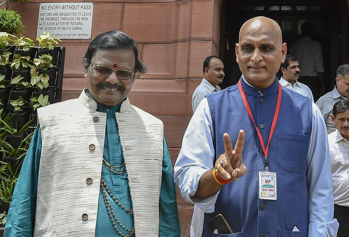 New Delhi: Newly sworn-in Rajya Sabha members Raghunath Mohapatra and Rakesh Sinha pose for a photograph, on the first day of the Monsoon Session of Parliament, in New Delhi on Wednesday, July 18, 2018. (PTI Photo /Kamal Singh)(PTI7_18_2018_000093B)