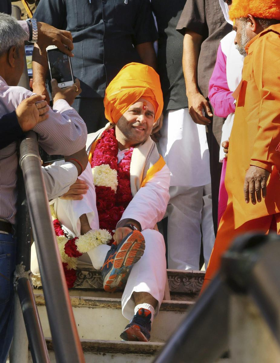 Congress President Rahul Gandhi leaves after offering prayers at Brahma Temple in Pushkaron Monday. PTI