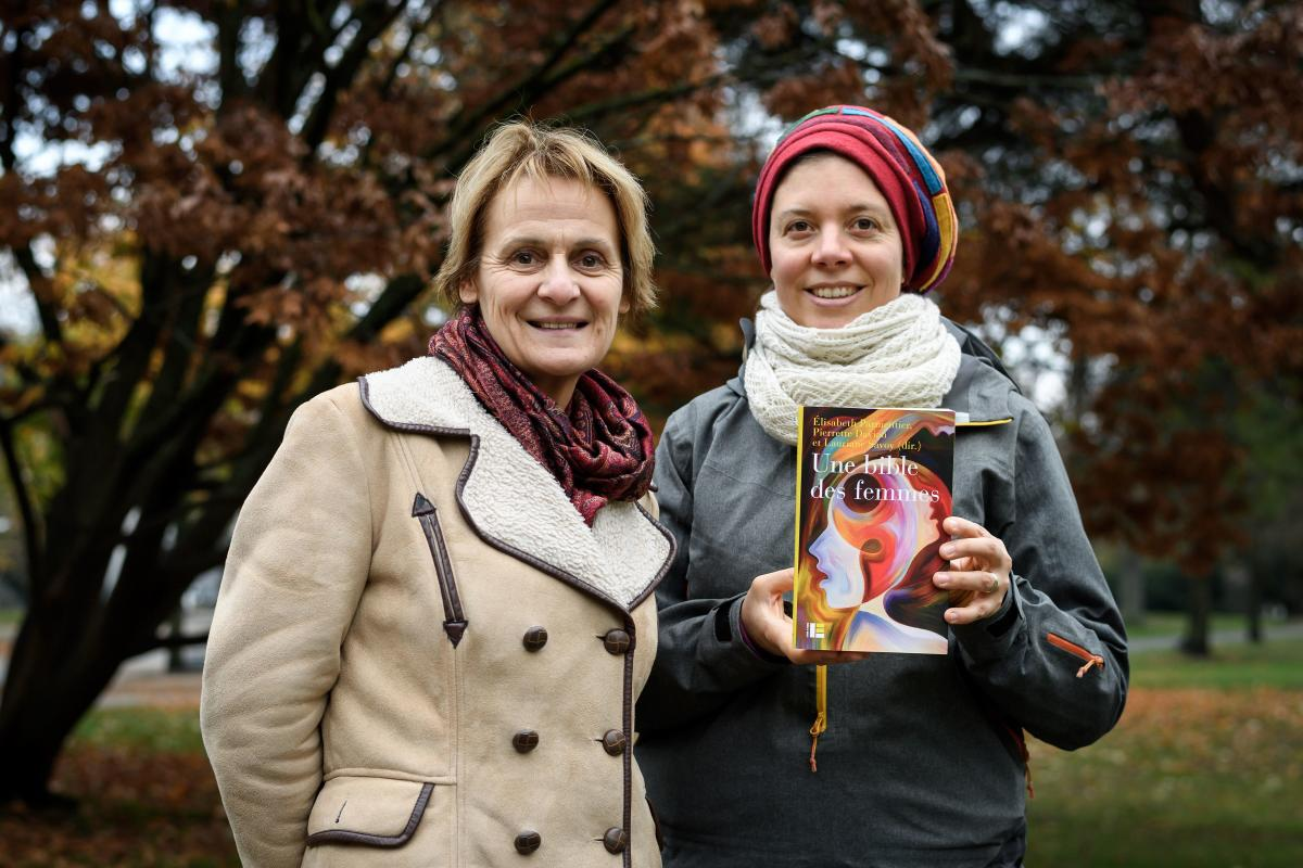 "Geneva theology professors Elisabeth Parmentier and Lauriane Savoy pose with an edition of ""A Women's Bible"" on November 20, 2018 in Geneva. AFP"