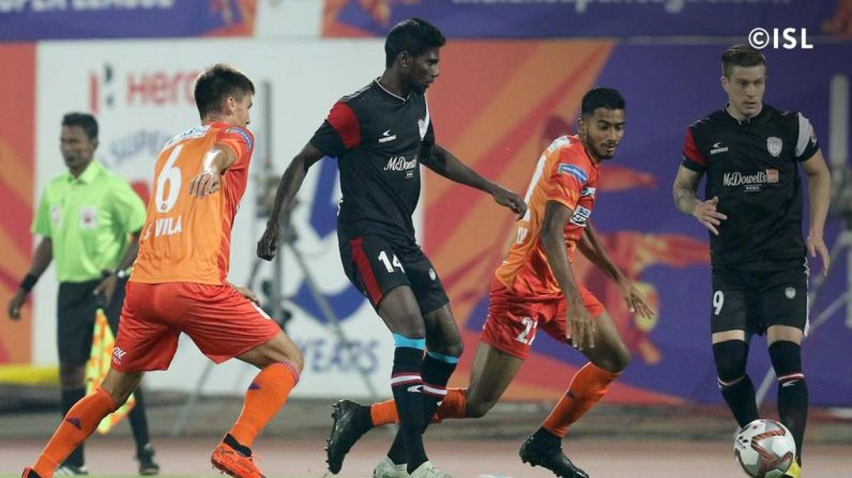 FC Pune City (orange) and NorthEast FC United players in action in an ISL game. ISL MEDIA