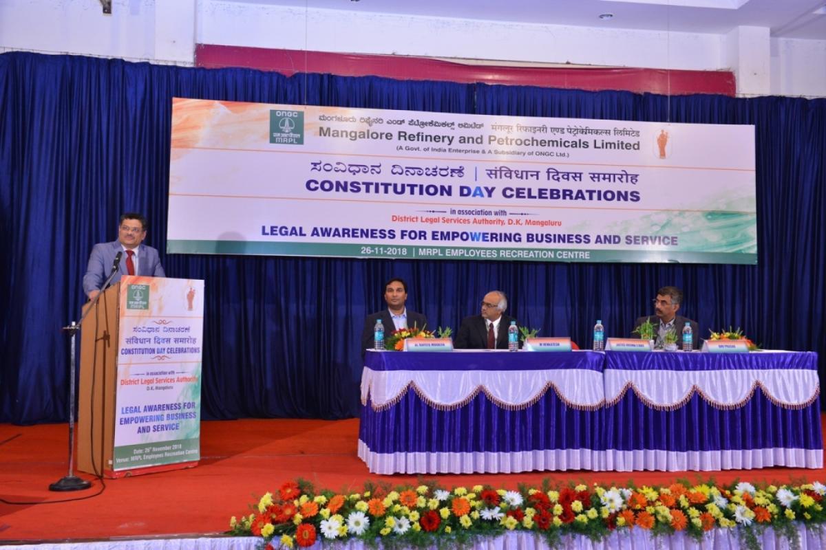 Karnataka High Court Judge Justice Krishna Shripad Dixit speaks at the Constitution Day programme organised by MRPL. MRPL Managing Director M Venkatesh, Group General Manager (HR) BHV Prasad and GM (Law) AL Rafeeq Moideen look on.