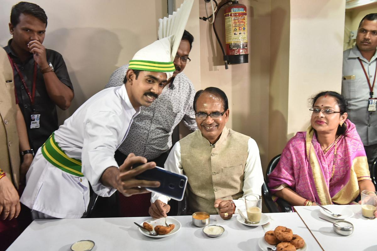 Madhya Pradesh Chief Minister Shivraj Singh Chouhan with his wife Sadhna Singh pose for a selfie at Indian Coffee House, in Bhopal. PTI Photo