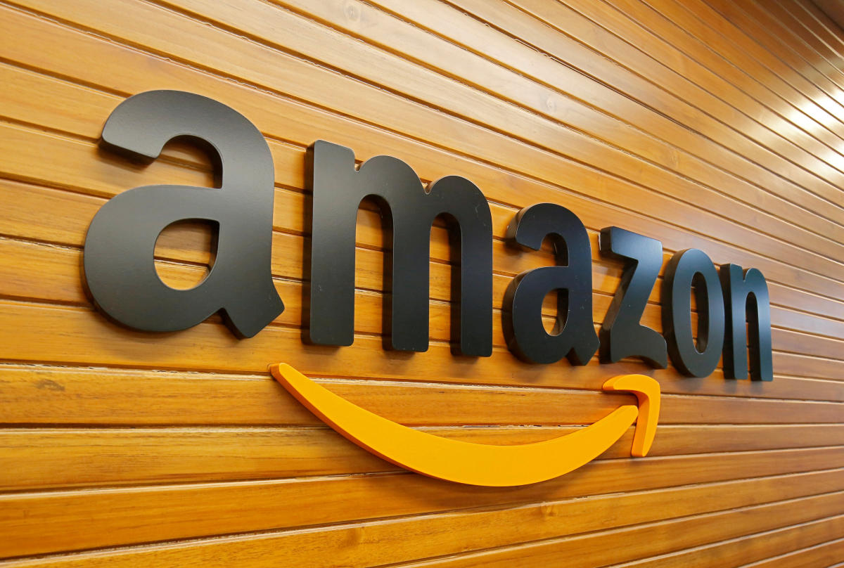 FILE PHOTO: The logo of Amazon is pictured inside the company's office in Bengaluru, India, April 20, 2018. Picture taken April 20, 2018. REUTERS/Abhishek N. Chinnappa/File Photo