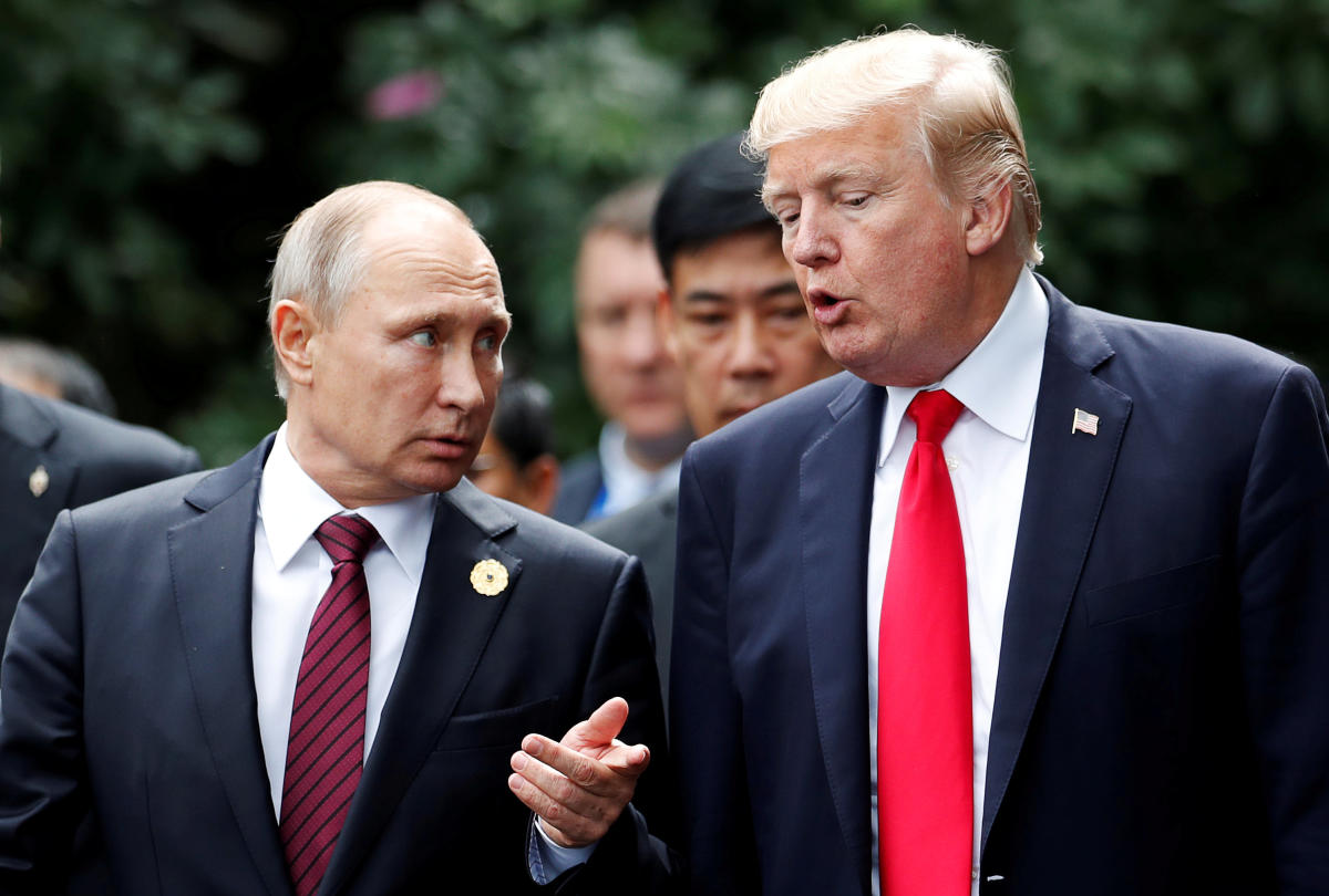 US President Donald Trump and Russia's President Vladimir Putin talk during the family photo session at the APEC Summit in Danang, Vietnam on November 11, 2017.Reuters