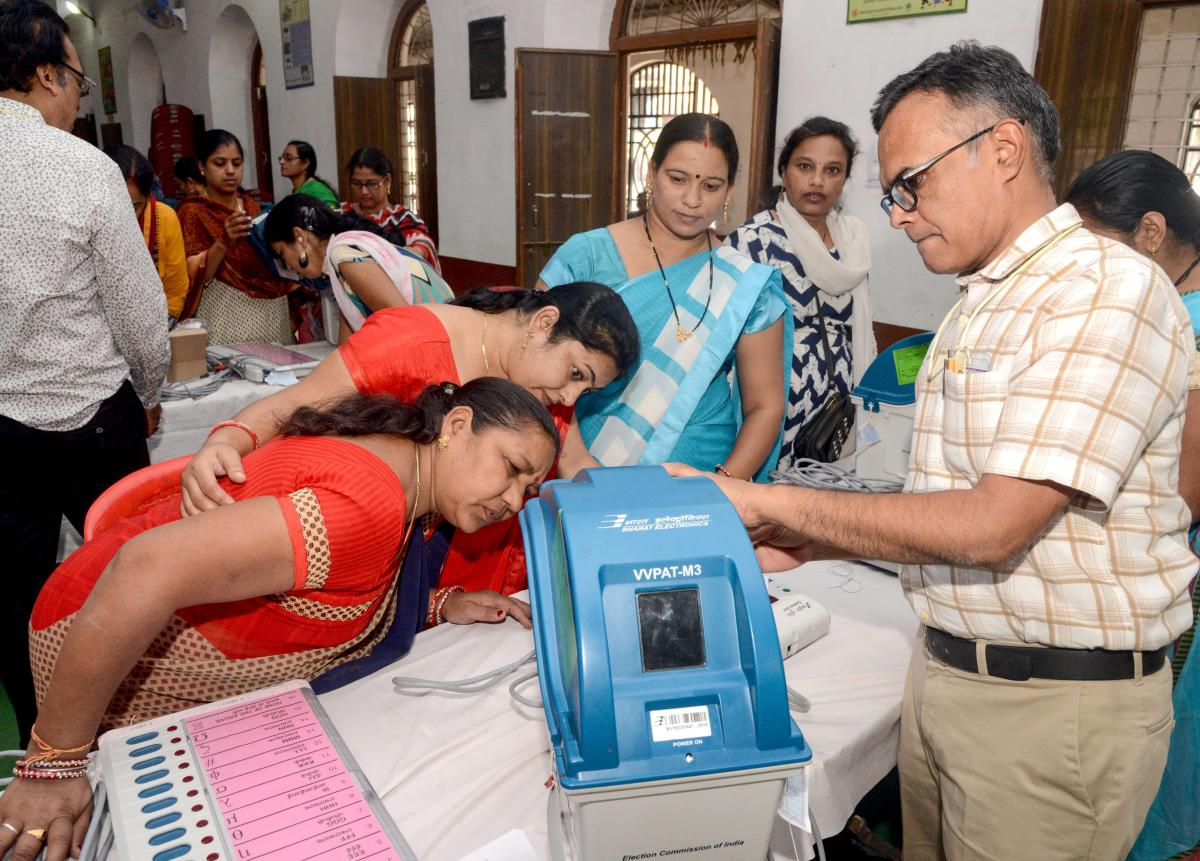 Electoral officials demonstrate the functioning of an Electronic Voting Machine and Voter-Verified Paper Audit Trail during a voter awareness program ahead of Madhya Pradesh State Assembly elections, in Jabalpuron Friday. PTI