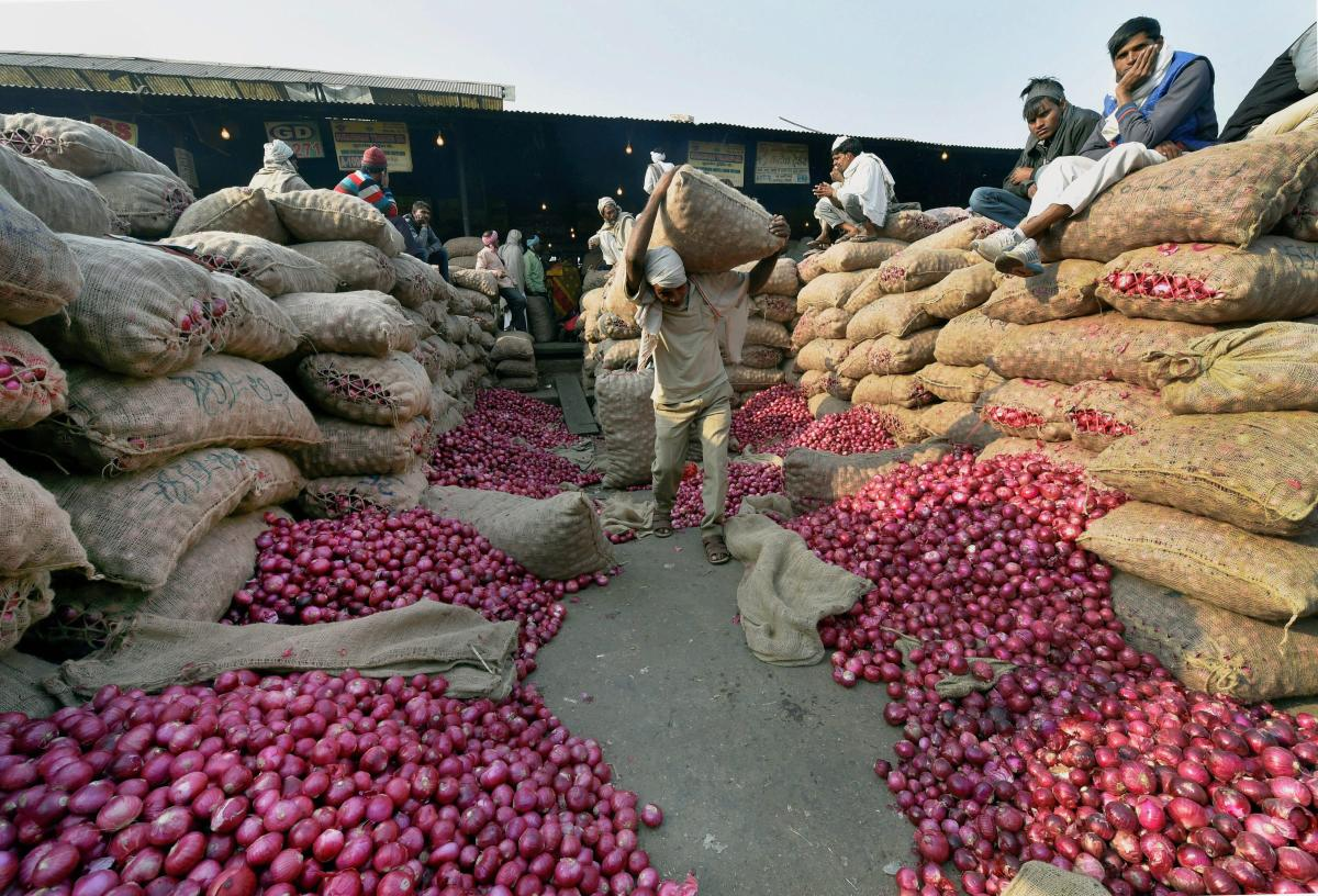 New Delhi: Heap of onion sacks at Azadpur Sabzi Mandi in New Delhi on Monday as the prices of the vegetable continue to soar. PTI Photo by Shahbaz Khan(PTI11_27_2017_000079B)