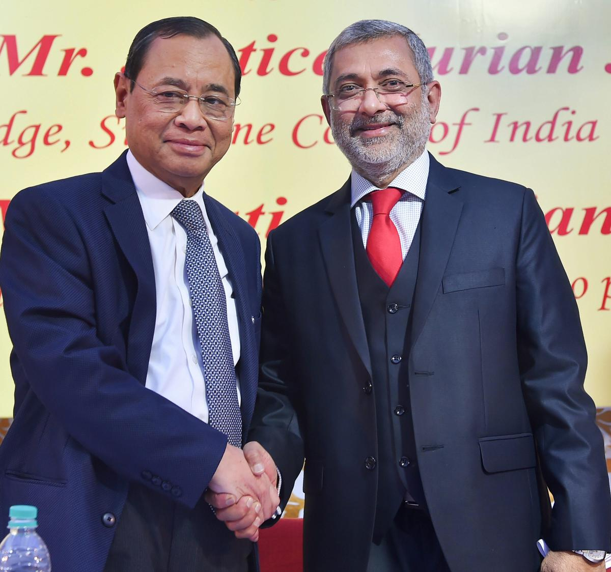 Chief Justice of India Justice Ranjan Gogoi (L) shakes hands with Justice Kurian Joseph during the latter's farewell function at the Supreme Court, in New Delhi, on Thursday. PTI