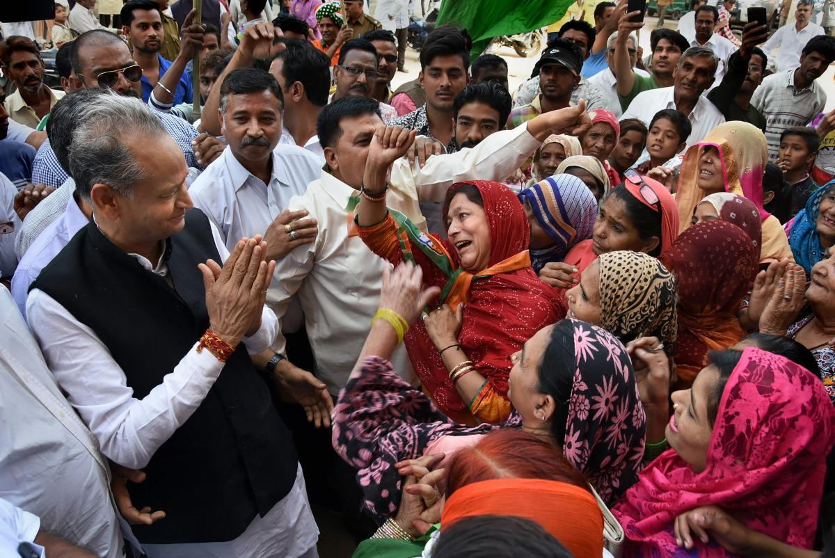 Congress leader and former chief minister Ashok Gehlot interacts duringan election campaign in his home constituency of Sardarpura in Jodhpur on November 20. PTI