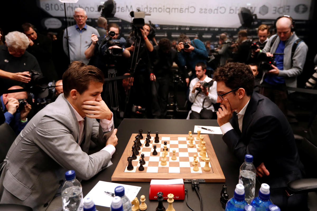 USA's Fabiano Caruana (right) and Norway's Magnus Carlsen (left) during round 12 of the World Chess Championship Final. REUTERS