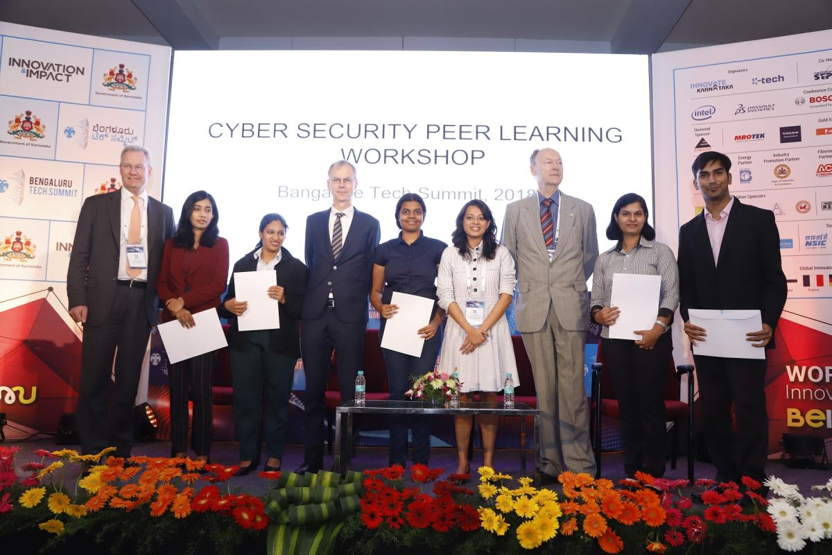 (From L to R) Deputy Director (Market and Operations), The Hague Centre for Strategic Studies Michel Rademaker, and Netherlands Ambassador for India, Nepal and Bhutan Marten Van den Berg (fourth from left), with IIIT-B students at the cybersecurity worksh