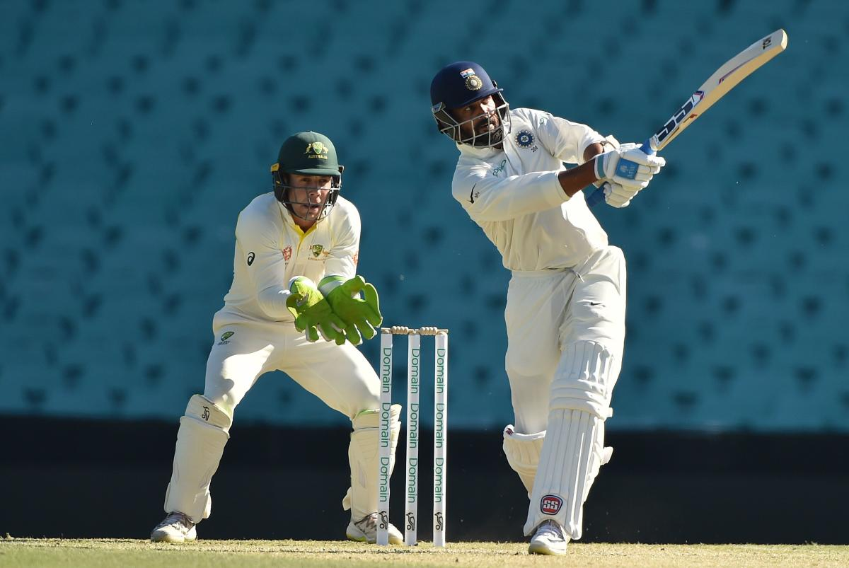Murali Vijay hits a shot on the fourth day of the tour match against Cricket Australia XI at the SCG in Sydney. AFP Photo