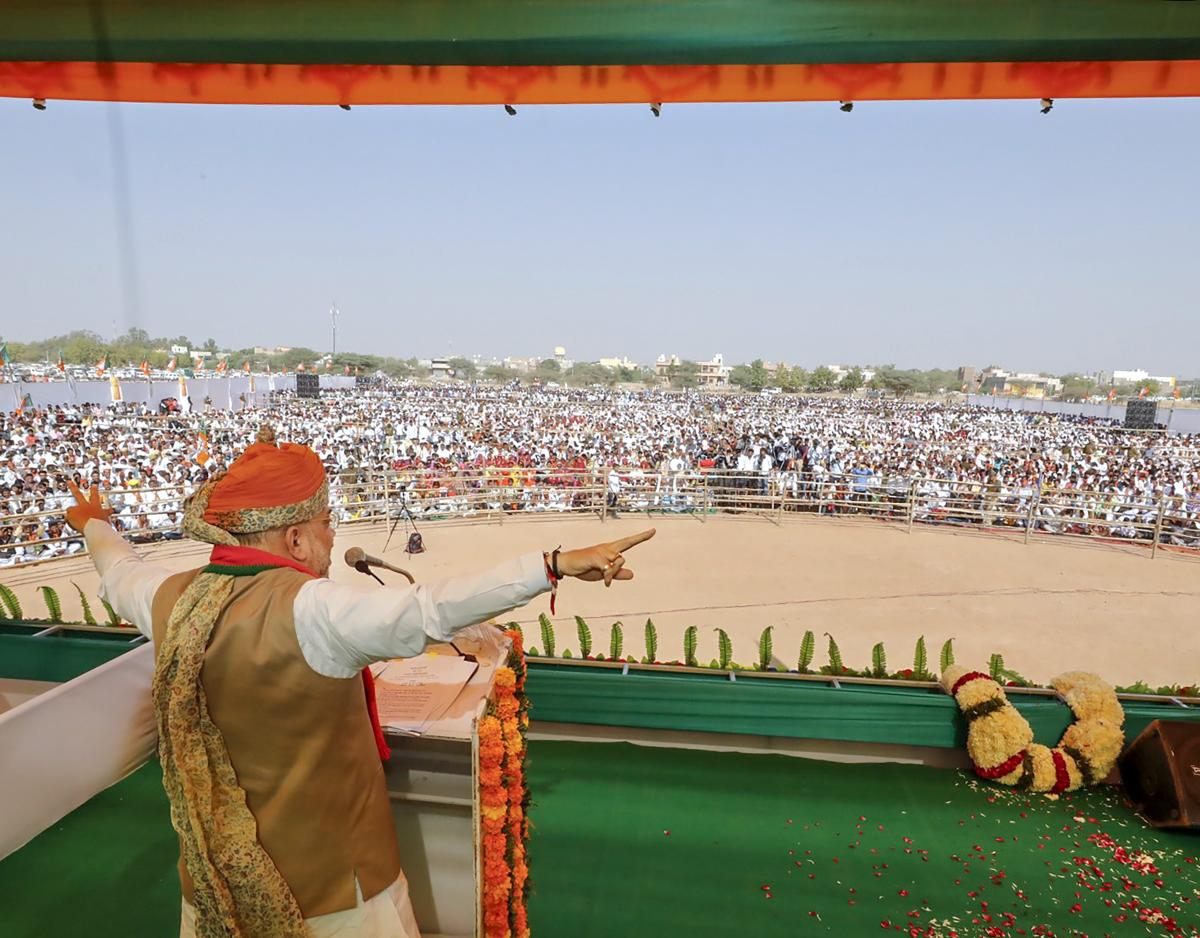 BJP National President Amit Shah addresses a public meeting, in Pahlodi of Jodhpur district, Rajasthan on Saturday. (PTI Photo)