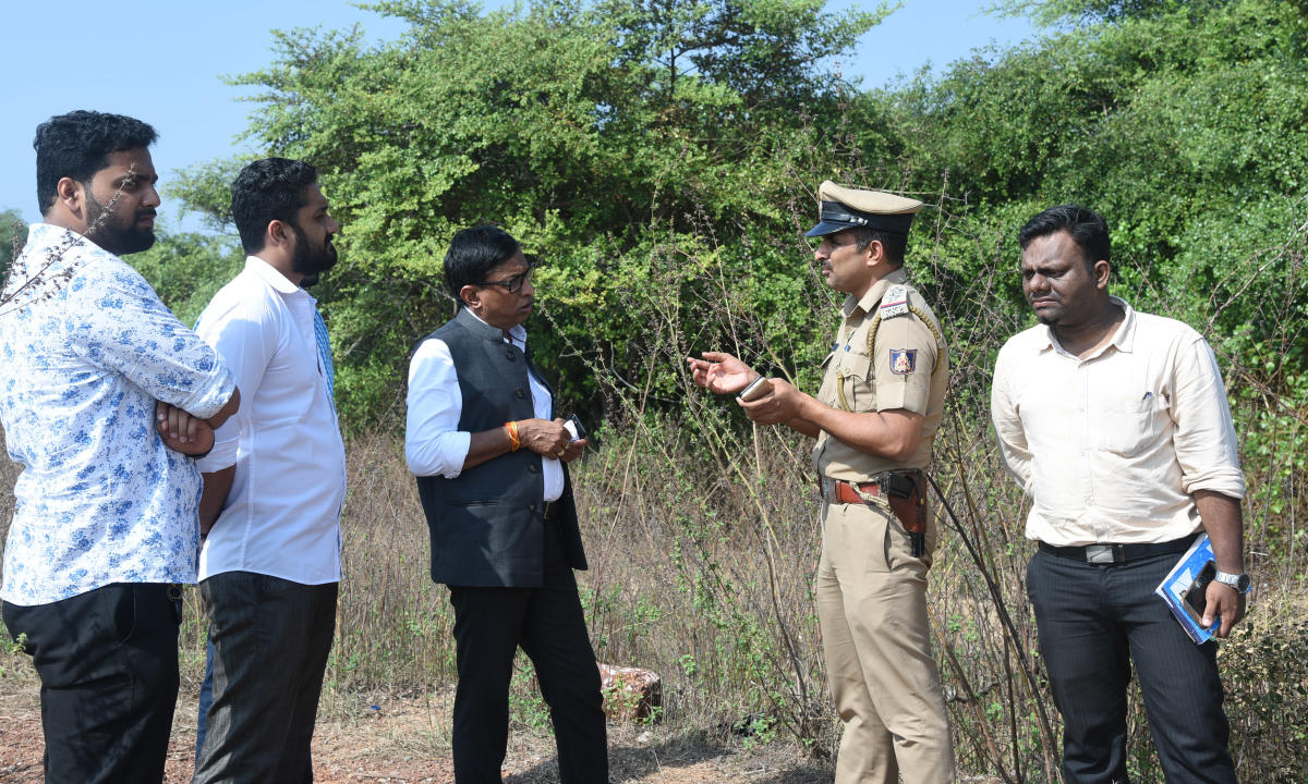 MLCS L Bhoje Gowda listens to a point explained by a police inspector at Alive Bagilu Beach near Thota Bengre on Saturday evening.