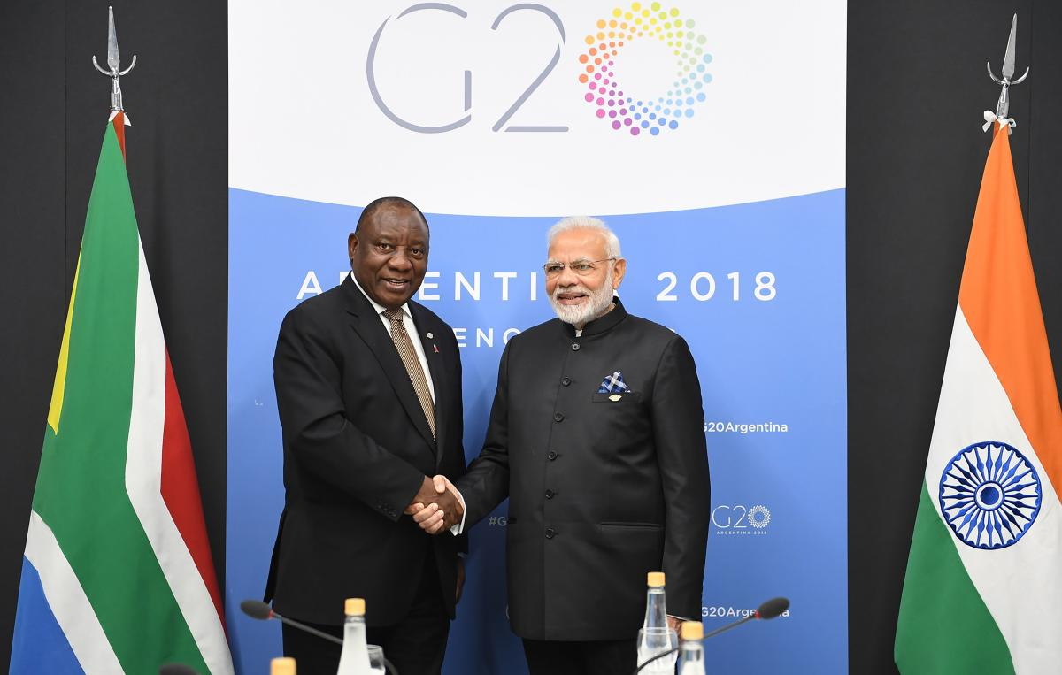 Prime Minister Narendra Modi shakes hands with President of South Africa Cyril Ramaphosa during the G20 Summit, in Argentina's capital Buenos Aires. (AFP Photo/PIB)