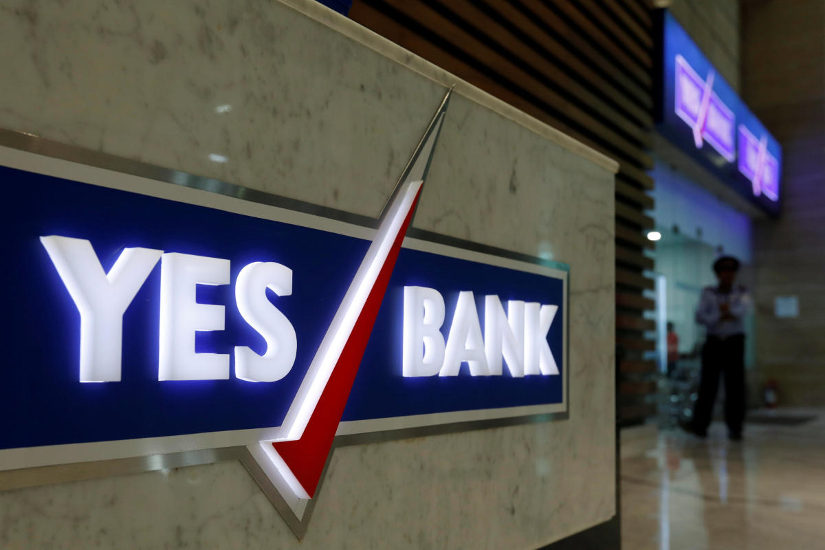 FILE PHOTO: A security guard stands outside a Yes Bank branch at its headquarters in Mumbai. REUTERS