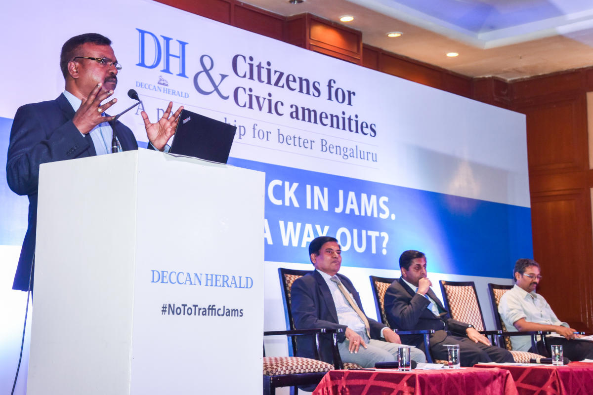 P Harishekaran, IGP and Additional Commissioner (Traffic) speaking in 'A City Stuck in Jams, Is There A Way Out?' Public Discussion programme organised by Deccan Hearld and Citizens for Civic amenities, A Partnership for better Bengaluru, at The Chancery Pavilion in Bengaluru on Saturday. B Basavaraaju, Principal Secretary, Transport Department, Ashish Verma, Mobility Expert, Indian Institute of Science (IISc),Vinay Sreenivasa, Advocate, Citizen Activist for Mobility, Alternative Law Forum are seen.DH Photo