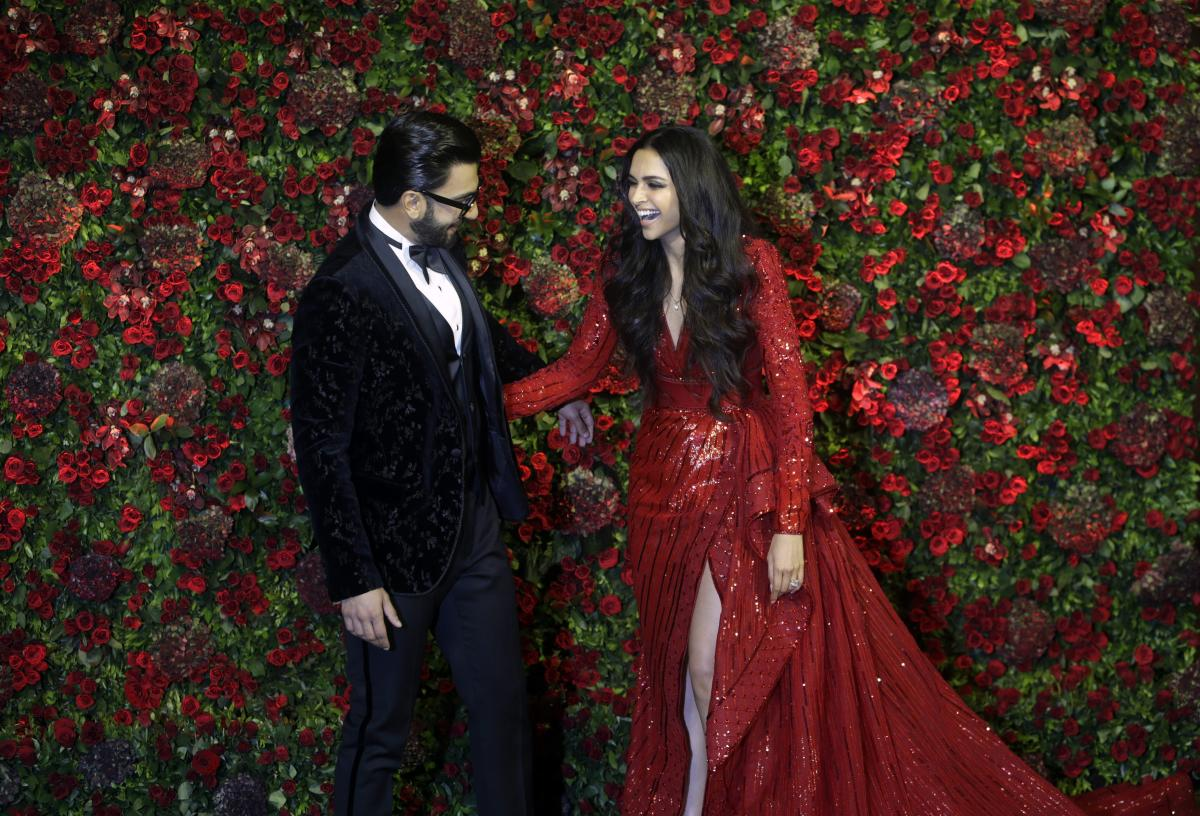 Bollywood actors Deepika Padukone, right, and Ranveer Singh at their wedding reception in Mumbai. (AP/PTI Photo)