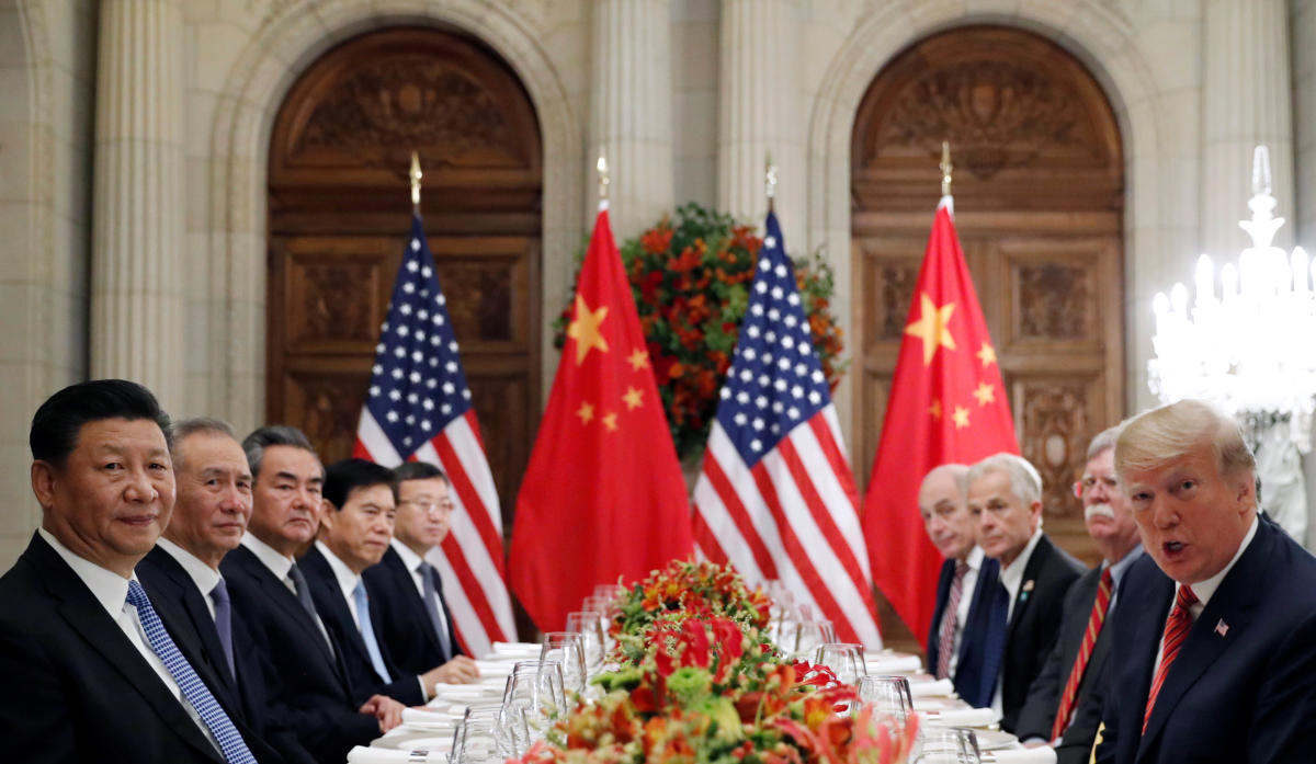 U.S. President Donald Trump, U.S. Secretary of State Mike Pompeo, U.S. President Donald Trump's national security adviser John Bolton and Chinese President Xi Jinping attend a working dinner after the G20 leaders summit in Buenos Aires, Argentina December