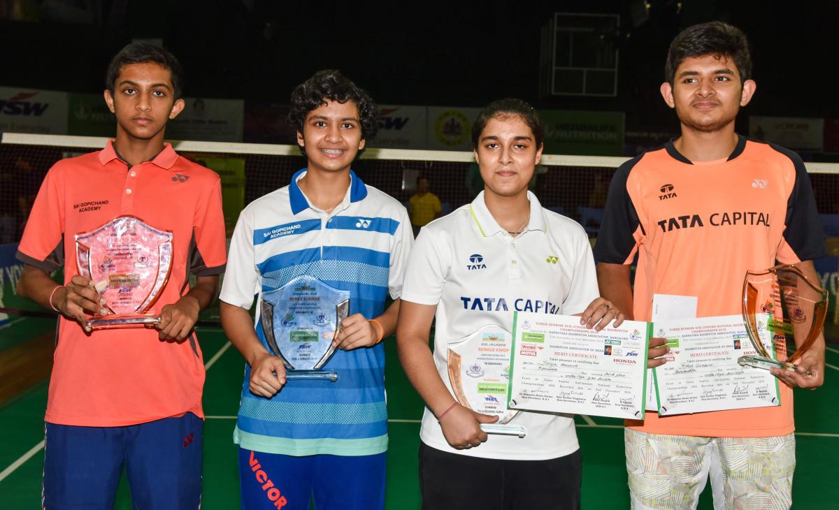 TRIUMPHANT: Winners of Sub-junior national badminton singles titles. FROM LEFT: Sai Vishnu Pullela (U-15), Tasnim Mir (U-15), Aditi Bhatt (U-17) and Rohan Gurbani (U-17). DH PHOTO