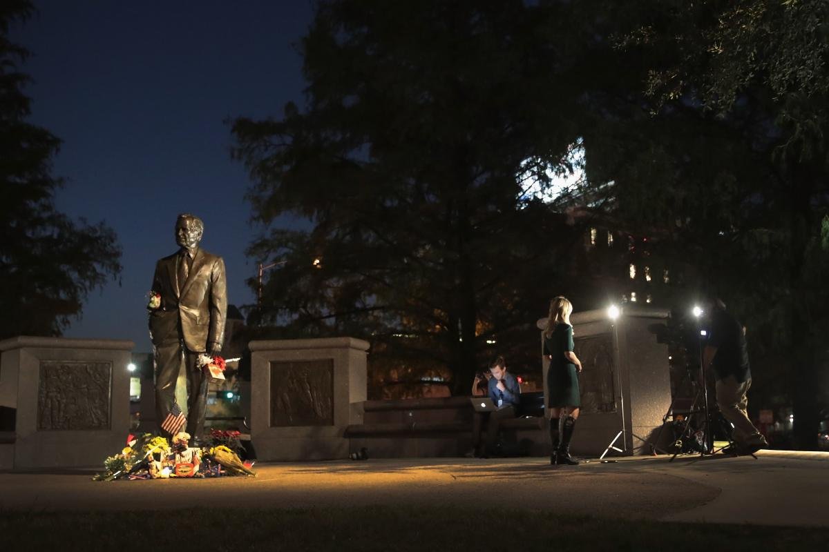 Flowers sit at the base of a statue of President George H.W. Bush near downtown on December 2, 2018 in Houston, Texas. AFP photo.