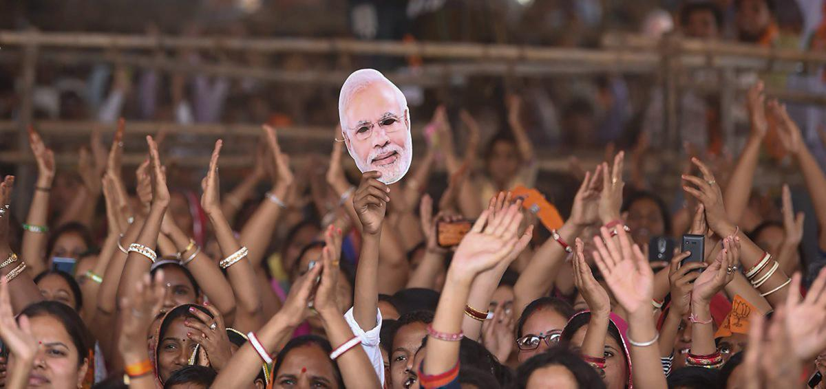 People gather to attend Prime Minister Narendra Modi's election rally in support of the BJP candidates, in Bhilwara, Rajasthan. PTI
