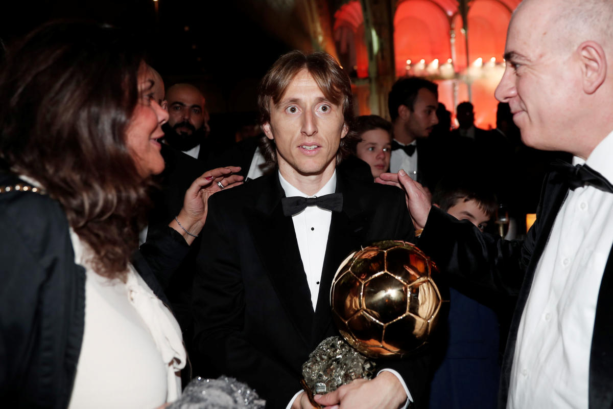 Real Madrid's Luka Modric and the Ballon d'Or award. Reuters