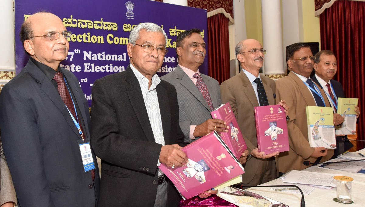 Madhya Pradesh State Election Commission Commissioner Parasuram releasing the 'Important Orders and Judgements on Elections To Rural and Urban Local Bodies' during the 27th Conference of All India State Election Commissioners Meeting, organised by Karnata