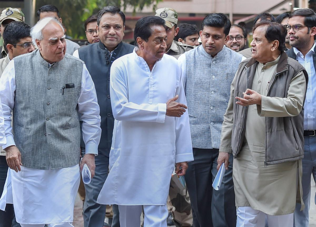 Congress leaders (L-R) Kapil Sibal, Kamal Nath, Ahmed Patel, and others leave after a meeting with the Election Commissioner at Nirvachan Sadan, in New Delhi, on Tuesday. PTI