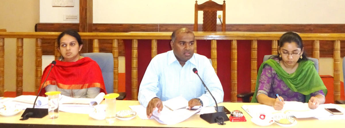 District In-charge Secretary Anbu Kumar chairs a meeting at the DC's office in Madikeri on Tuesday. Deputy Commissioner P I Sreevidya and ZP CEO Lakshmipriya are also seen.