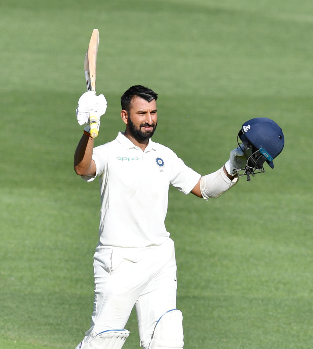India's Cheteshwar Pujara celebrates after reaching his century against Australia in the first Test in Adelaide on Thursday. Reuters