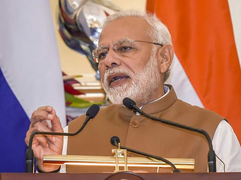 The book is a detailed assessment of Modi's impact on Indian polity and its course in the future. PTI file photo.