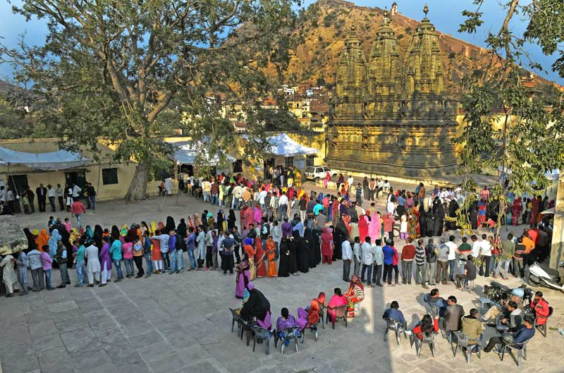 The historic Jaipur city goes to polls. Hundreds of voters casting their franchise in the backdrop of an ancient Shiv temple and Amber Fort. (Photo by Suman Sarkar)
