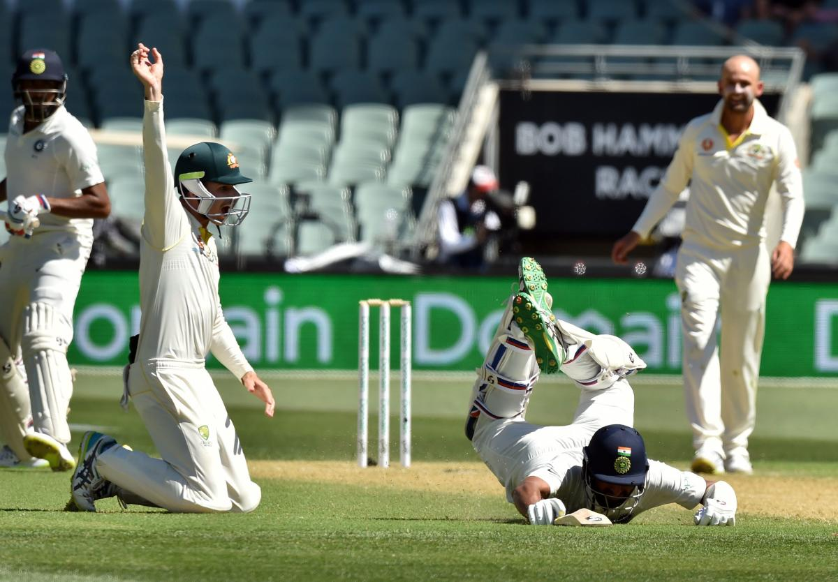Cheteshwar Pujara (C) survives a run-out attempt as Australia's Peter Handscomb (2nd L) looks on during day one of the first cricket Test match at the Adelaide Oval on December 6. AFP