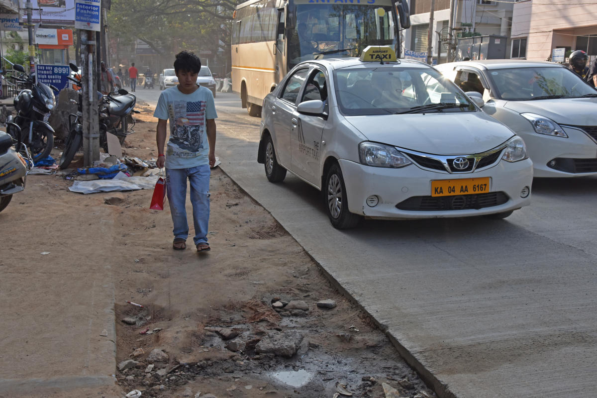 Foot path is merged with road after white topping work at Koramangala in Bengaluru on Thursday. Photo by S K Dinesh