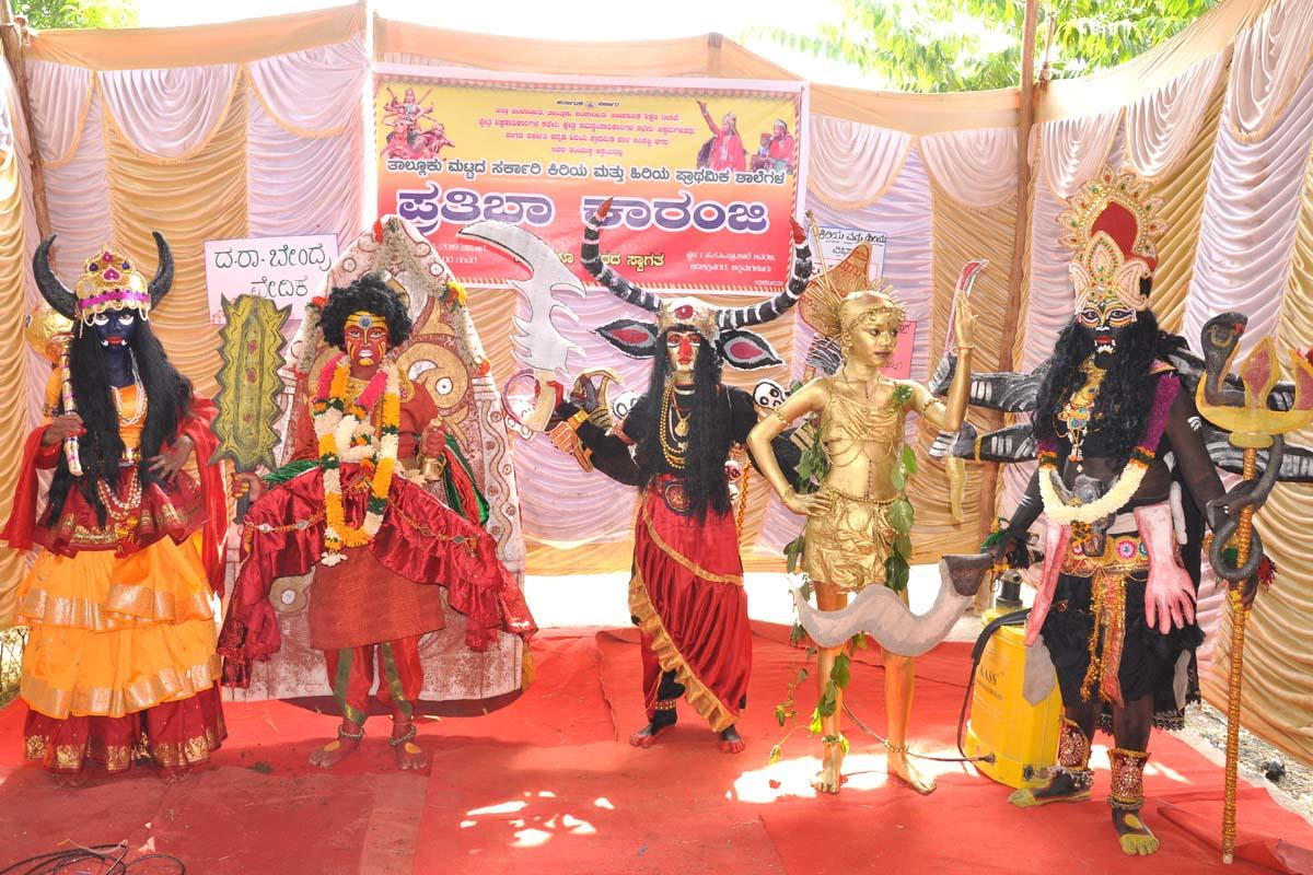 Students take part in a fancy dress competition organised as a part of Prathibha Karanji competitions at the Government Kannada Higher Primary School at Adishaktinagara Layoutin Chikkamagaluru on Saturday.