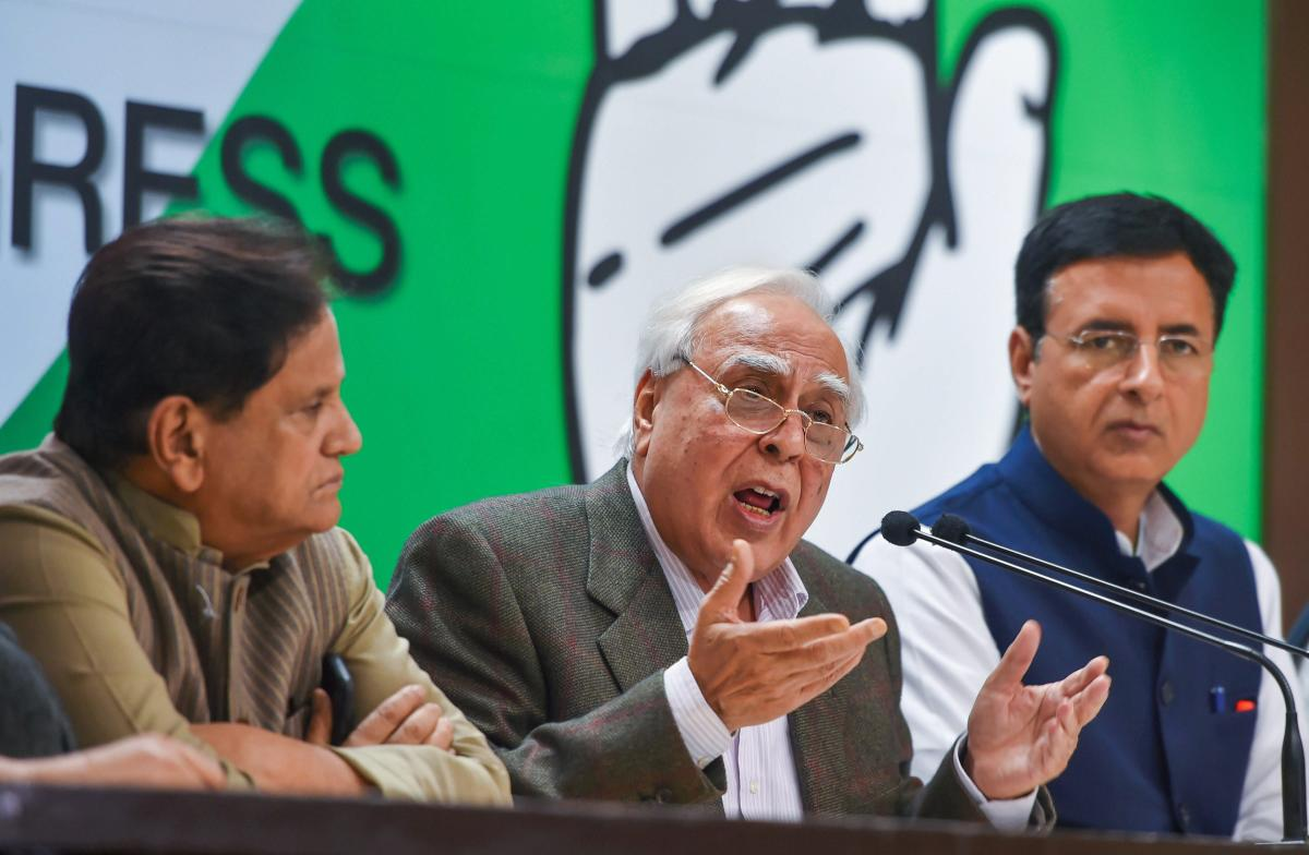 Congress leaders Kapil Sibal, Ahmed Patel and Randeep Surjewala during a special press briefing in New Delhi on Saturday. PTI